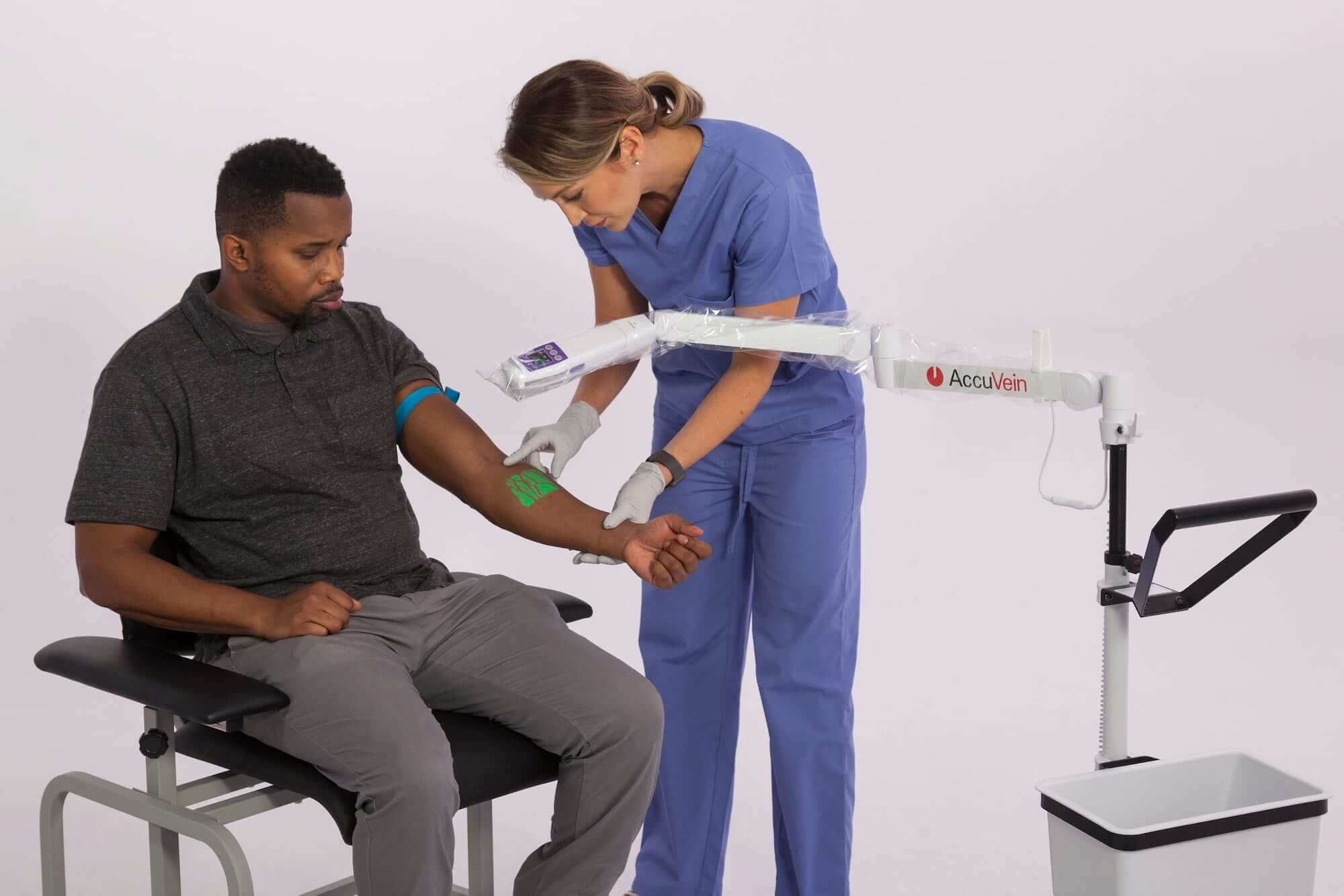 AccuVein AV500 in use with wheeled stand